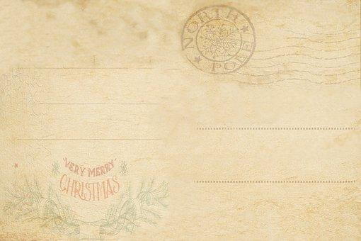 Vánoční pozadí zobrazující béžovou tištěnou pohlednici s volnými řádky pro text a razítkem s nápisem North Pole.