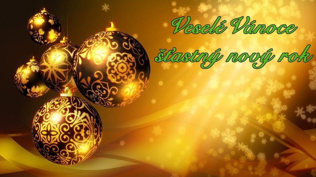 """Zlaté obrázkové vánoční přání s baňkami a nápisem """"Veselé Vánoce šťastný nový rok"""" napravo."""
