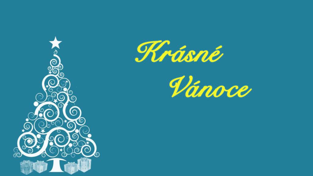 """Modré vánoční přání s bílým stromečkem a žlutým nápisem """"Krásné Vánoce""""."""